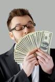 金钱嗅到。 免版税库存照片