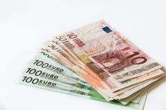 金钱在事务和财务的白色隔绝的欧元 免版税库存图片