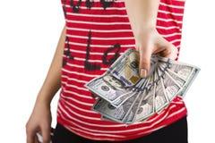 金钱在妇女的手上 免版税库存照片