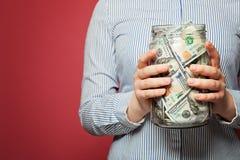 金钱在瓶子的美元 投资和银行业务概念 库存照片