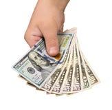 金钱在白色背景的手上 免版税库存图片