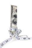 金钱栓与测量的磁带 免版税图库摄影