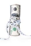 金钱栓与测量的磁带 免版税库存照片