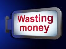 金钱概念:浪费在广告牌背景的金钱 库存图片