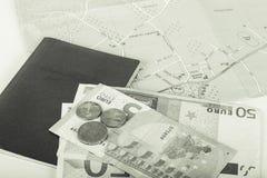 金钱欧元、护照和地图在白色背景 空间为 库存图片