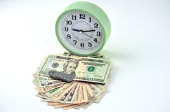 金钱现金爱好者和时钟 免版税库存图片