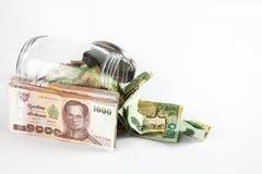 金钱瓶子有孤立白色背景 免版税库存照片