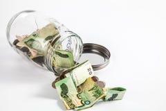 金钱瓶子有孤立白色背景 免版税库存图片