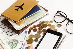金钱电话护照玻璃和地图在白色背景, calcul 库存照片