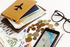 金钱电话护照玻璃和地图在白色背景, calcul 免版税图库摄影