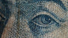 金钱眼睛 库存图片