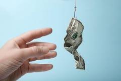 金钱诱饵设了陷井 企业成功和危险 债务附庸 免版税库存照片