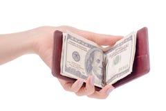 金钱金钱钱包的美元夹子在手中 库存照片