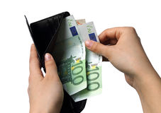 金钱钱包在妇女手上 免版税图库摄影