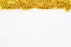 金闪烁的衣服饰物之小金属片在背景顶部 免版税库存照片