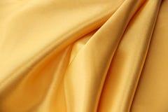 金黄丝绸纹理织品背景 免版税库存图片