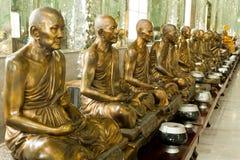 金黄修士雕象 库存图片