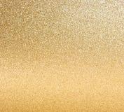 金黄发光的光。 抽象背景 免版税库存照片