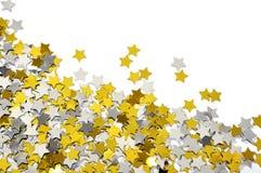 金黄和银色星形五彩纸屑 免版税库存照片