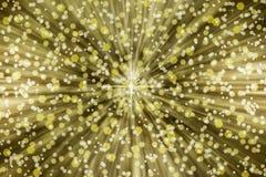 金黄和银色闪闪发光在Starbust背景中 图库摄影