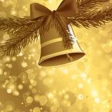 金黄圣诞卡的背景 库存图片