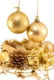 金黄圣诞节的装饰 库存图片
