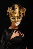 金黄屏蔽当事人性感的妇女 库存照片