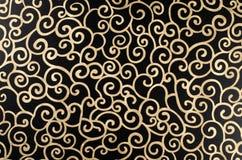 金黄抽象的蔓藤花纹 库存照片