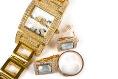 金黄时钟和珠宝 库存照片