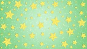 金黄星在绿色背景中 库存图片