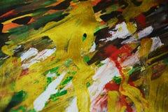 金黄橙色绿色闪耀的油漆背景,五颜六色的生动的蜡状的颜色,对比创造性的背景 免版税库存照片