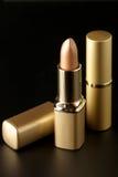 金黄的化妆用品 库存图片