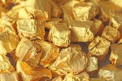 金黄的背景 纯净的金子锭或矿块  金叶 茶树脂普洱哈尼族彝族自治县 免版税库存图片
