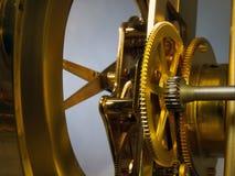 金黄的钟表机构 库存图片