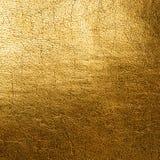 金黄皮革背景 免版税库存图片