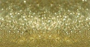 金黄背景的闪烁 免版税库存照片