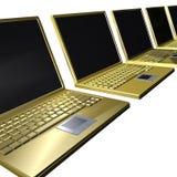 金黄膝上型计算机行 免版税库存图片