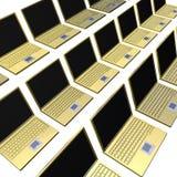 金黄膝上型计算机许多行 免版税图库摄影