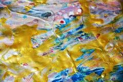 金黄蓝色弄脏了蜡闪耀的背景,水彩生动的背景,纹理 库存图片