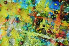 金黄蓝色闪耀的泥泞的蜡状的背景 免版税库存照片