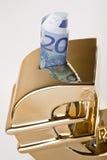 金黄货币贪心除之外 免版税库存照片
