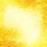 金黄闪烁发光的抽象背景 免版税库存照片