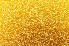 金黄闪烁圣诞节和新年背景 de的纹理 免版税库存照片
