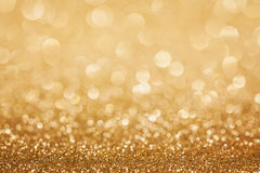 金黄闪烁圣诞节背景 免版税库存图片