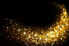 金黄闪烁线索有星形背景 免版税库存照片