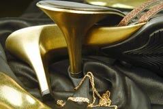 金黄鞋子妇女 免版税库存照片