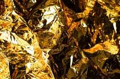 金黄颜色抽象背景从纸的 免版税图库摄影