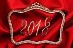 金黄2018年在一个古色古香的框架有红色背景 图库摄影