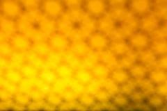 金黄bokeh摘要被弄脏的轻的背景 免版税库存照片