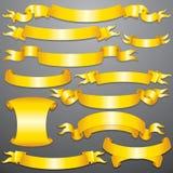 金黄丝带,在背景隔绝的横幅 库存图片